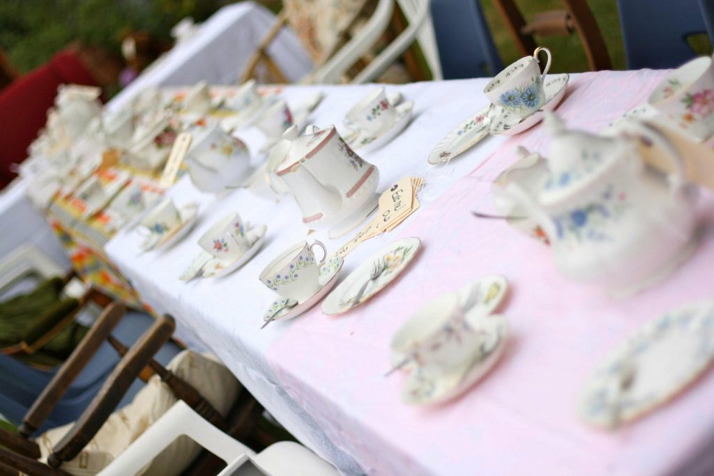 Vintage crockery hire set up for a Mad Hatter's Theme Tea Party